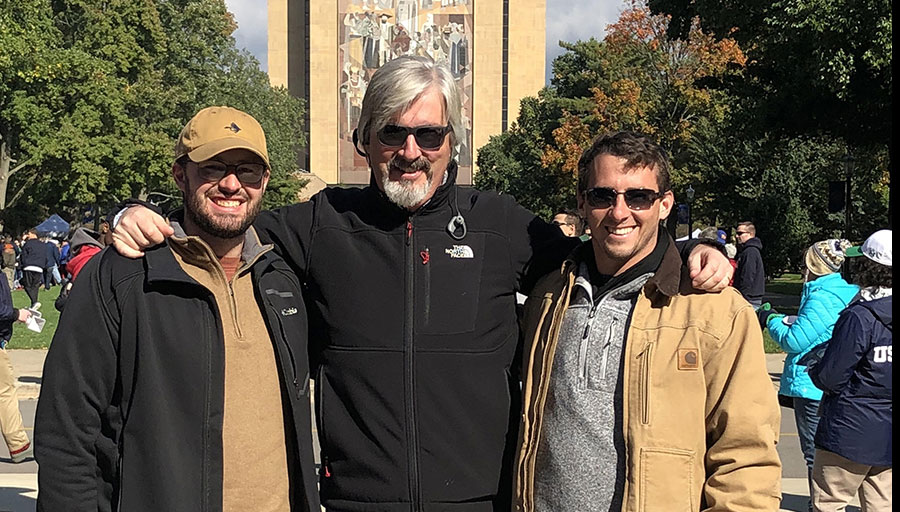 "Christopher, Zachary, and me at Notre Dame Stadium in front of ""Touchdown Jesus."""