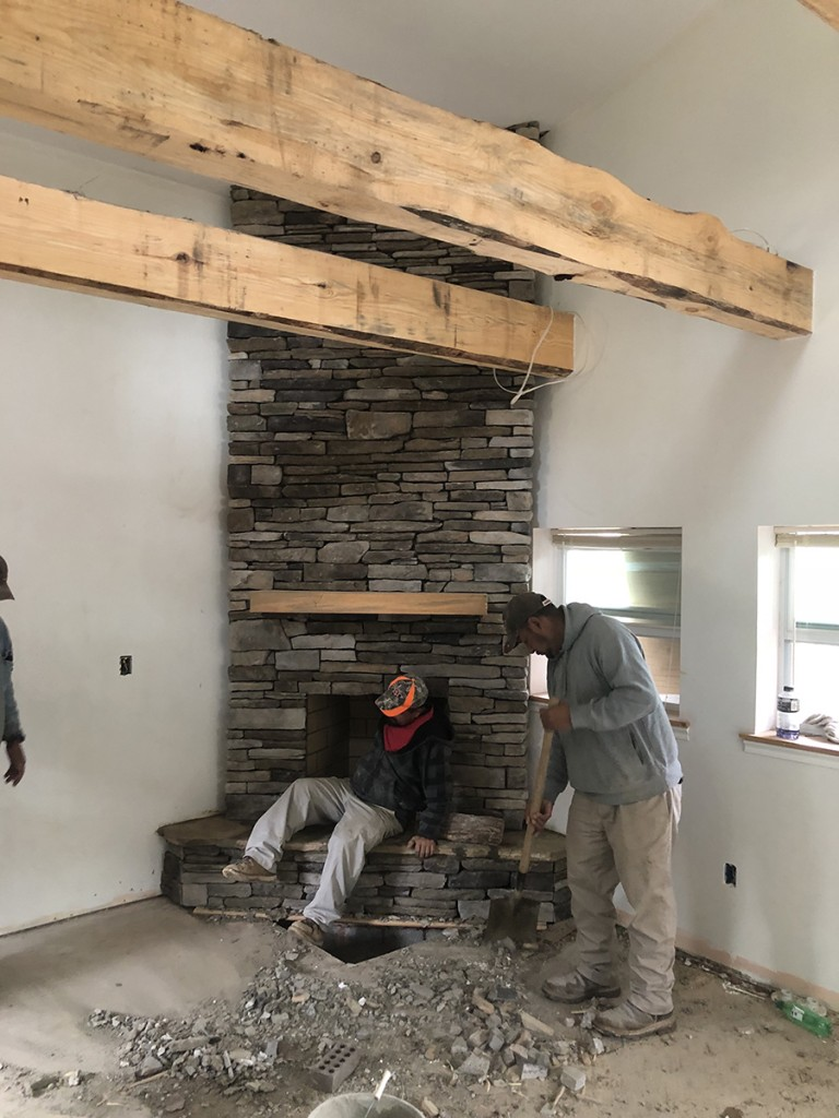 A real fireplace — I hate the gas inserts — and locally milled pine beams