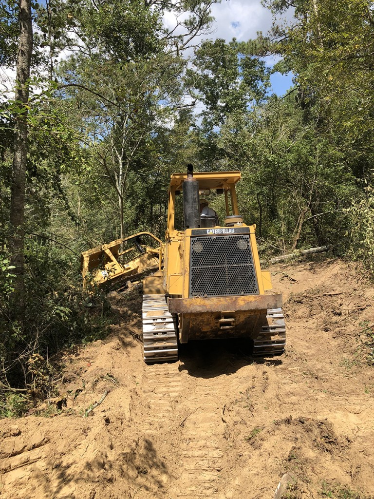 This was quite a drama. A 26-ton bulldozer making a road from the main property down to the Duck River nearly tipped into the river. Here a 26-ton loader pulls the dozer out.